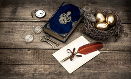 Golden easter eggs and antique bible book Royalty Free Stock Photo