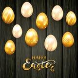 Golden Easter eggs on black wooden background. Golden Easter eggs with decorative patterns on black wooden background. Gold lettering Happy Easter, illustration Royalty Free Stock Images