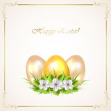 Golden Easter eggs with flowers Stock Image
