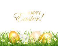 Golden Easter eggs in the green grass Stock Photo