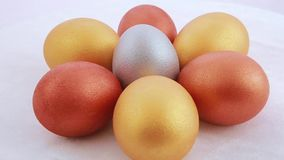 Golden easter eggs isolated over white background stock video footage