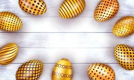 Golden Easter eggs on light wooden background. stock illustration