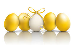 5 Golden Easter Eggs Mirror. 4 golden easter eggs on the mirror Royalty Free Stock Image