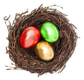 Golden easter eggs in nest isolated on white Royalty Free Stock Images
