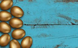 Golden Easter Eggs On A Wooden Table. Gold Easter Eggs On Blue Brushed Wooden Background. Rustic Colored Background. Invitation Royalty Free Stock Image