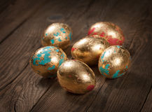 Golden Easter eggs on the table. Concept Royalty Free Stock Photos