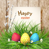 Golden Easter eggs on a wooden background Royalty Free Stock Photography