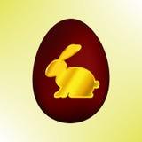 Golden Easter rabbit on a red Easter egg. Isolate royalty free illustration