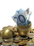 The golden egg. A golden egg hatching a twenty euro note Royalty Free Stock Photography