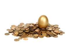Golden egg. And coins Royalty Free Stock Images