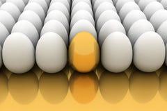 Golden egg. Golden easter egg among similar white eggs Stock Photos
