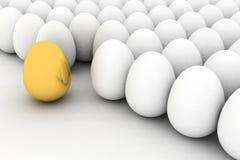 Golden egg. Golden easter egg among similar white eggs Stock Photo