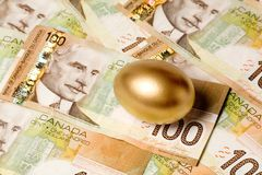 Golden egg. And canadian dollars, concept of Making Money Stock Photo