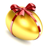 Golden Egg. With red ribbon and bow Royalty Free Stock Photo