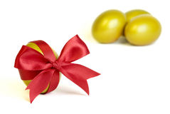 Golden egg. With red bow ribbon stock photo
