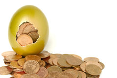 Golden egg. With a lot of coins stock photo