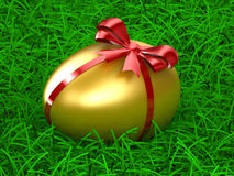 Golden Egg. On green grass Royalty Free Stock Images
