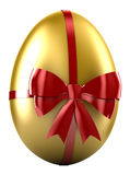 Golden Egg. With red satin bow Royalty Free Stock Photos