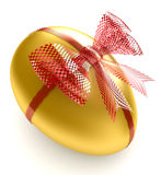 Golden Egg. With red satin bow Royalty Free Stock Photo