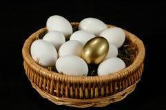 The Golden Egg. Golden egg among white eggs Royalty Free Stock Photos