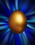 Golden egg in a blue vortex Royalty Free Stock Images