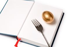 Golden egg and book. Concept of education Stock Photography