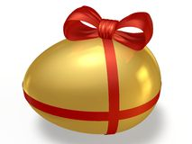 Golden egg with a bow. Golden egg with a red bow on a white background Stock Photography