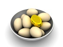 Golden egg in a bowl Stock Image