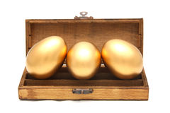 Golden egg in the box. On white background Royalty Free Stock Image