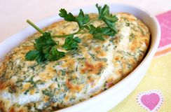 Golden egg-cheese pie with fresh parsley stock photo