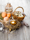 Golden egg of chickens in nest Royalty Free Stock Photography