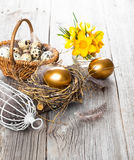 Golden egg of chickens in nest Royalty Free Stock Images