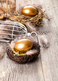 Golden egg of chickens in nest Royalty Free Stock Photo