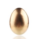 Golden egg close up. Royalty Free Stock Image