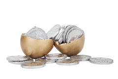 Golden egg with coins. Broken golden eggs with coins on white background Royalty Free Stock Photo