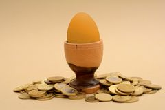Golden Egg concept with gold coins pile Royalty Free Stock Image