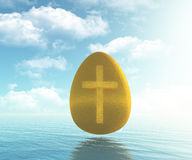 Golden egg with cross Stock Photo