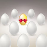 Golden Egg. Difference, uniqueness concept image. Golden egg standing out from the others stock illustration
