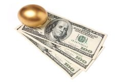 Golden egg and dollars Royalty Free Stock Photo
