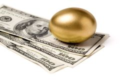Golden egg and dollars. Concept of Making Money Stock Photography