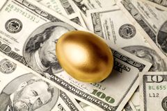 Golden egg and dollars. Concept of Making Money Royalty Free Stock Photos