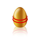 Golden egg with elastic/rubber for colouring. On white background Stock Images