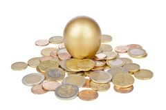 Golden egg with euro coins. On a white background Stock Photo