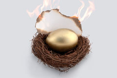 Golden Egg on fire Royalty Free Stock Image