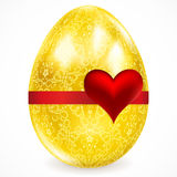 Golden egg with floral ornaments. Stock Images