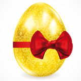 Golden egg with floral ornaments. Royalty Free Stock Images