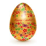 Golden egg with flowers Royalty Free Stock Photo