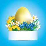 Golden egg and flowers. Royalty Free Stock Photography