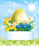 Golden egg and flowers. Stock Image