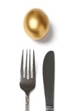 Golden egg and fork Royalty Free Stock Photo